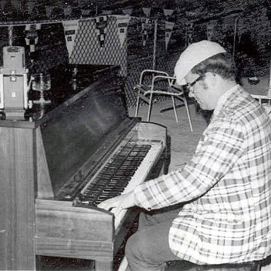 Tom Loughlin Jr plays the piano poolside at the IHRA Nationals at Empire Dragway- Holiday Inn Geneseo