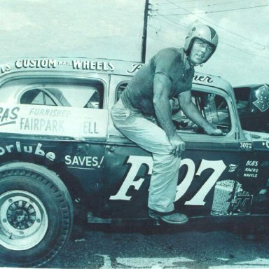 Red Farmer climbs from his Modified Special sedan at Birmingham in 1962