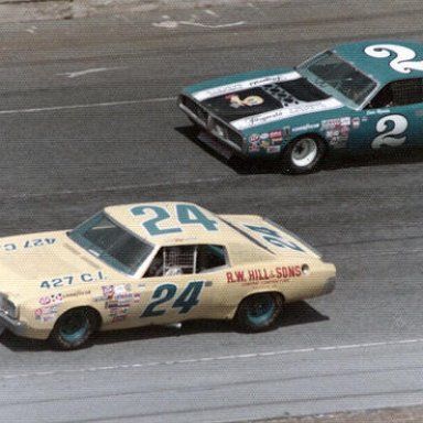 Cecil Gordon races with Dave Marcis_