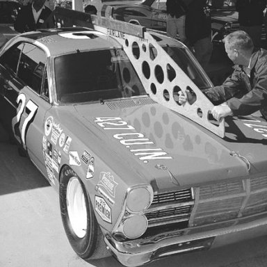 The Banjo Matthews Ford of A_J_ Foyt gets a template check before the 1967 Daytona 500___