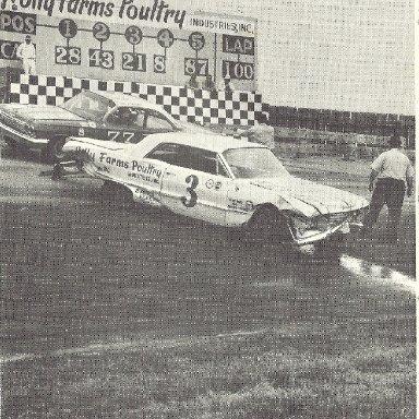 Junior Johnson crashed Roy Mayne squeezes through