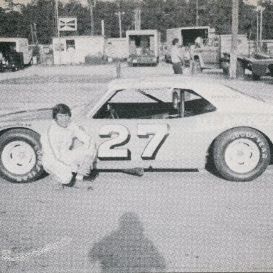 Sam Sommers with Jack Pennington's freshly painted car in the background.