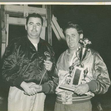 Zervakis holding Trophy