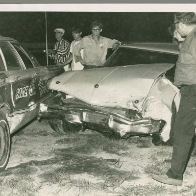 Butch Zervakis checking out the damage as Sonny Hutchins looks on