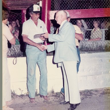 Zervakis receiving award from J.M.Wilkerson at Southside Speedway