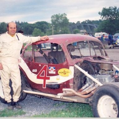 Lou Lazzaro Poses with Coupe