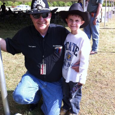 Tim Leeming and boy in matching cowboy hats