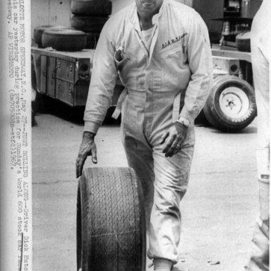 Dick Hutcherson Rolling a Tire Press Photo
