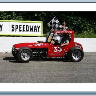 Ralph Monhay getting the flag for his 3 lap ride at the Langley Heritage speedway Langley BC Canada