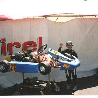 Brendan standing by kart