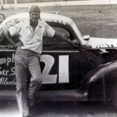 Bill France with one of Raymond Parks' 39' Fords. Circa 1940