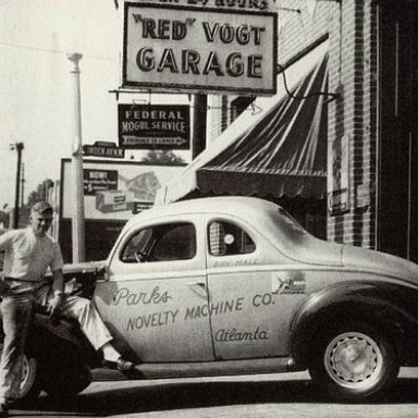 Red Vogt with a Roy Hall car outside his famous Spring Street Shop