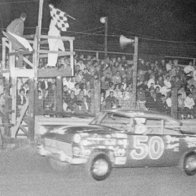 Slick Gibbons Takes Checkered Flag after winning race at Sumter Speedway.