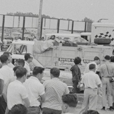 Jarrett leaning against hauler Bridgehampton 1963
