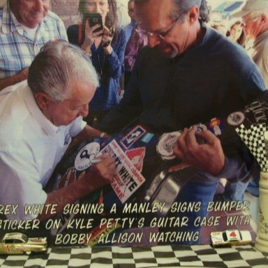 Rex White Signing Manley Signs Bumper Sticker on Kyle Petty Guitar Case