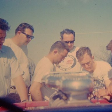 Mr. Norm, Gary Dyer, and Fans looking thru the window of the 65 AWB Dodge
