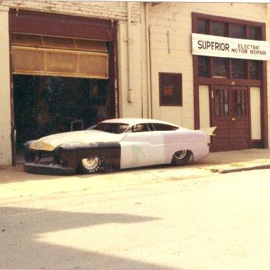 fletcher harrison merc in front of shop
