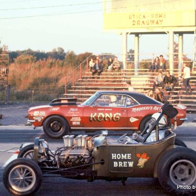 Phil Burkart Sr foreground races against Utica Chuck Dapice