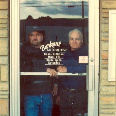 The Phil Burkarts Jr and Sr in shop door
