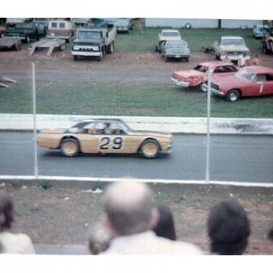 "Dadge Dart of car owner ""Chubby"" Arrington an the back stretch at Franklin County"