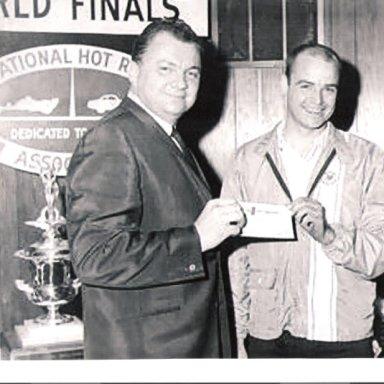 Ed collecting the big check -1967 NHRA SS Champion