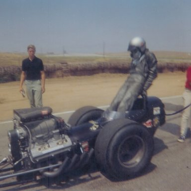 "Danny Ongais getting out of the ""Mangler"" top fuel dragster at 1965 HRM Championships"