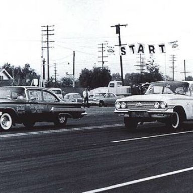 Terry Prince 1960 in the far lane.