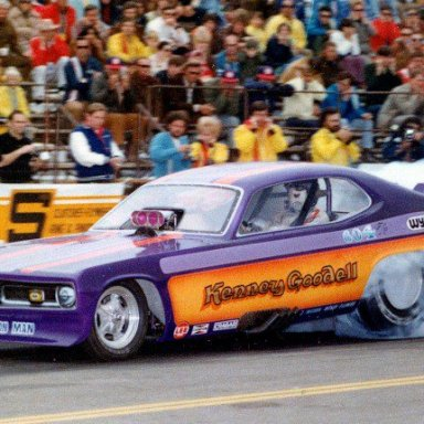 ACTION MAN KENNEY GOODELL SMOKIN THE TIRES IN HIS DUSTER