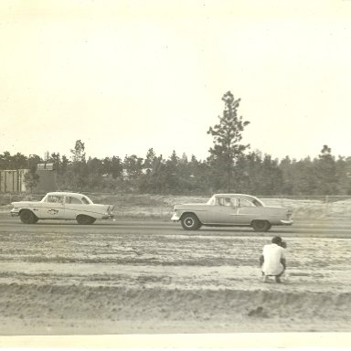 Jerry Martin in 57 cheverolet and Ernest Dinkins in 55 Chevrolet in run made at Augusta International Speedway